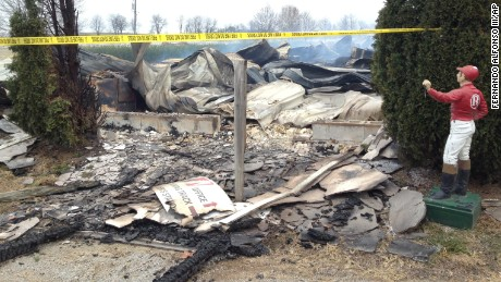 Debris covers the ground after a fire at the Mercury Equine Center outside Lexington, Kentucky.