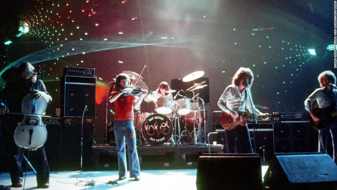 "Cellists Melvyn Gale and Hugh McDowell, violinist Mik Kaminsky, guitarist and singer Jeff Lynne, drummer Bev Bevan, bassist Kelly Groucutt, and piano player Richard Tandy of  ""Electric Light Orchestra"" will also be inducted. The group is seen here performing in August 1977 in Los Angeles, California."