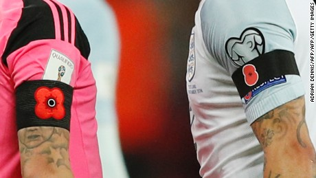 Players wore poppies on their armbands in a World Cup qualifier between England and Scotland.