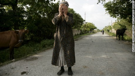A woman reacts after separatist militia destroyed much of the village of Tkviavi, Georgia, on August 7, 2008. The Ossetian separatist movement sparked Russian intervention in neighboring Georgia, escalating the affair into a military conflict.