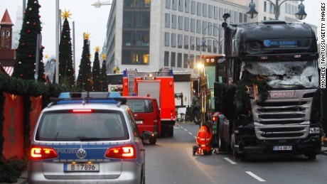 Security and rescue workers tend to the area after a lorry truck ploughed through a Christmas market  on December 20, 2016 in Berlin, Germany. So far 12 people are confirmed dead and 45 injured. Authorities have confirmed they believe the incident was an attack and have arrested a Pakistani man who they believe was the driver of the truck and who had fled immediately after the attack. Among the dead are a Polish man who was found on the passenger seat of the truck. Police are investigating the possibility that the truck, which belongs to a Polish trucking company, was stolen yesterday morning.