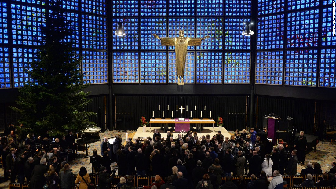 Mourners gather at the Kaiser Wilhelm Memorial Church near the crash site.