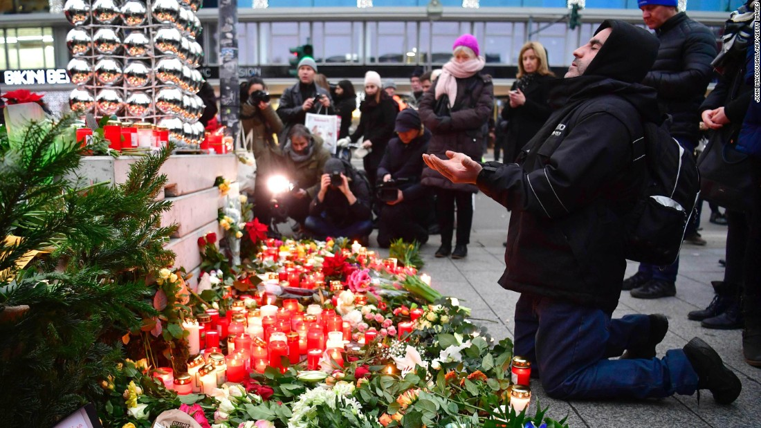 A man prays at a Berlin memorial on December 20.