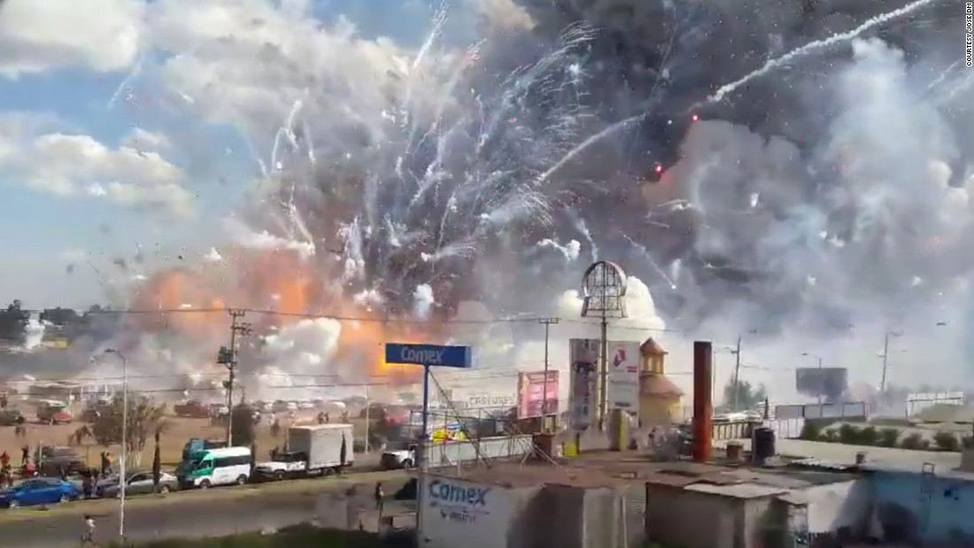 Fireworks explode from the San Pablito market in Tultepec, Mexico, on Tuesday, December 20. Authorities say dozens were killed in blasts at the market, which was especially busy with people buying fireworks for the holidays.