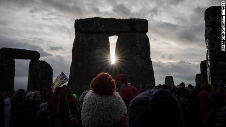 Thousands gather to watch the sun rise over Stonehenge on the Winter and Summer solstices.