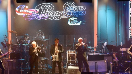 BEVERLY HILLS, CA - FEBRUARY 14:  (L-R) Recording artists Keith Howland, Walfredo Reyes, Jr. (seated on drum riser), James Pankow, Walter Parazaider, Lee Loughnane, Tris Imboden (seated on drum riser), Robert Lamm and Jason Scheff of the music group Chicago perform onstage during the 2016 Pre-GRAMMY Gala and Salute to Industry Icons honoring Irving Azoff at The Beverly Hilton Hotel on February 14, 2016 in Beverly Hills, California.  (Photo by Kevork Djansezian/Getty Images)