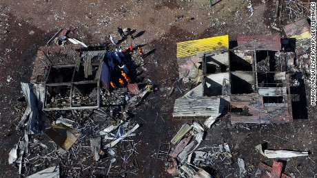 Aerial view of Mexico's biggest fireworks market in Tultepec suburb, Mexico State, after a massive explosion on the eve killed at least 32 people, on December 21, 2016. Mexico worked Wednesday to identify charred bodies left by an explosion at its biggest fireworks market, as authorities investigated what caused the multi-colored salvo of destruction. Forensic experts are carrying out genetic analyses to identify the badly burned remains from Tuesday's blast, with just 13 victims identified so far, said state prosecutor Alejandro Gomez. / AFP / Mario VAZQUEZ        (Photo credit should read MARIO VAZQUEZ/AFP/Getty Images)