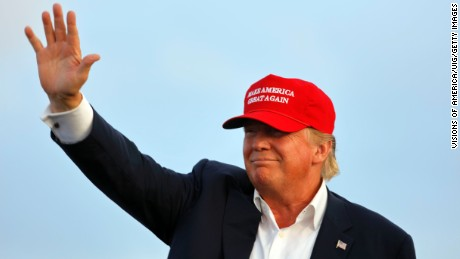 San Pedro, CA, September 15, 2015, Donald Trump, 2016 Republican Presidential Candidate, Waves During A Rally Aboard The Battleship USS Iowa In San Pedro, Los Angeles, California While Wearing A Red Baseball Hat That Says Campaign Slogan 'Make America Great Again.'. (Photo by: Visions of America/UIG via Getty Images)