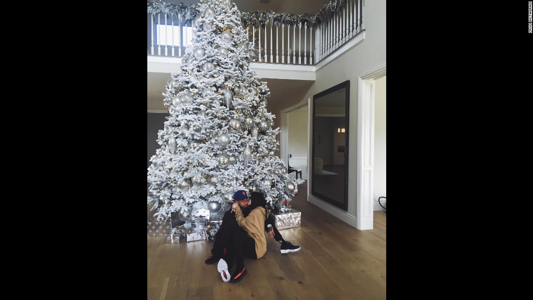 Kylie Jenner snapped this pic while sitting in front of her enormous tree with boyfriend, Tyga.