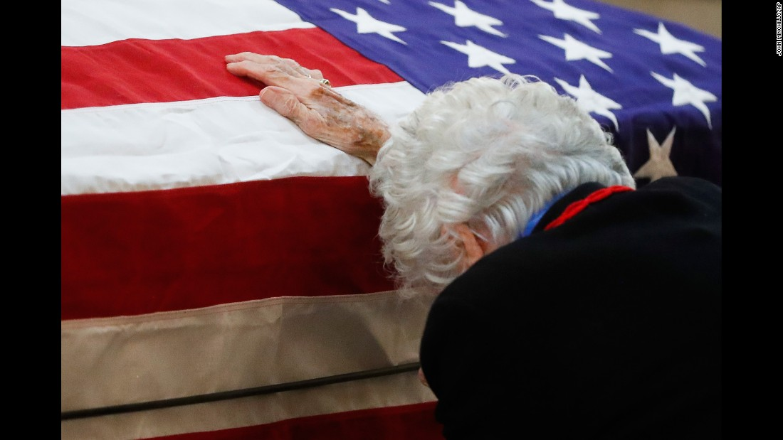 "Annie Glenn rests her hand on the casket of her husband, former astronaut and US Sen. John Glenn, as he lies in repose at the Ohio Statehouse on Friday, December 19. Glenn, the first American to orbit the Earth, <a href=""http://www.cnn.com/2016/12/08/health/john-glenn-dead/"" target=""_blank"">died December 8 </a>at the age of 95."