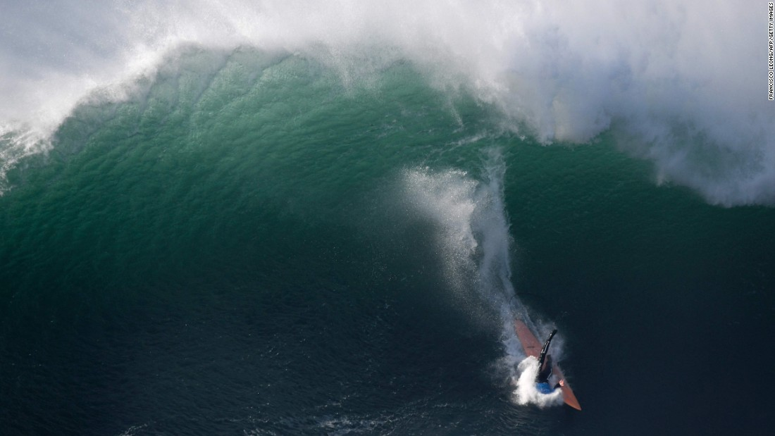 Big-wave surfer Nic Lamb wipes out while competing in Nazare, Portugal, on Tuesday, December 20.