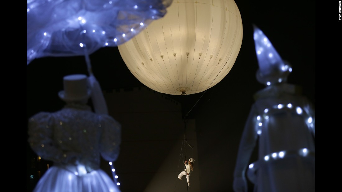 An artist performs at the inauguration of an ice-skating rink in Milan, Italy, on Friday, December 16.