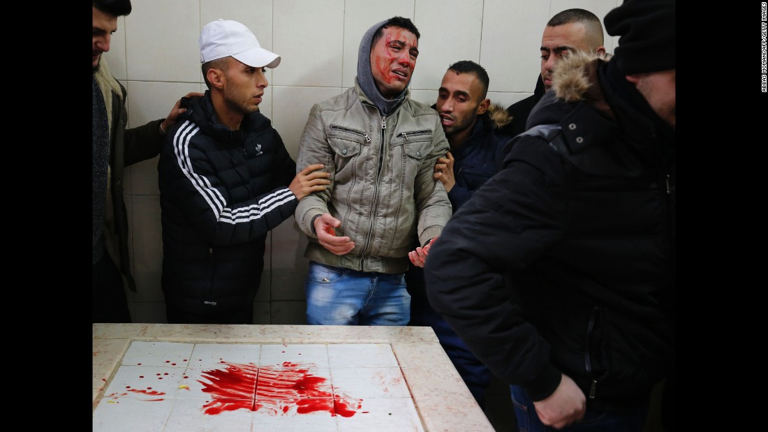 A mourner reacts in Ramallah, West Bank, after spreading his face with the blood of Ahmad al-Kharoubi, a 19-year-old Palestinian who was fatally shot during clashes with Israeli soldiers in Jerusalem on Thursday, December 22. A spokeswoman with the Israeli army said soldiers were attacked as they tried to demolish the home of a man who went on a deadly shooting rampage in October, according to Agence France-Presse.