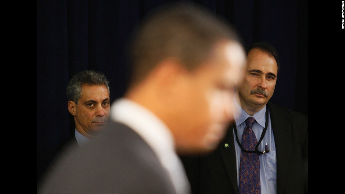 Axelrod and White House Chief of Staff designate Rahm Emanuel listen to Obama speak at a news conference in Chicago in December 2008.