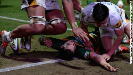 NORTHAMPTON, ENGLAND - MARCH 27:  George North  of Northampton Saints lies injured after scoring a try and after colliding with Nathan Hughes of Wasps during the Aviva Premiership match between Northampton Saints and Wasps at Franklin's Gardens on March 27, 2015 in Northampton, England.  (Photo by Tony Marshall/Getty Images)