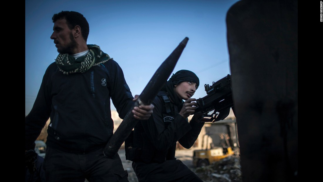 A Free Syrian Army fighter aims his weapon during clashes with government forces in Aleppo on Tuesday, January 15, 2013.