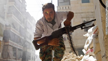 "A Free Syrian Army fighter takes cover during clashes with Syrian Army in the Salaheddine neighbourhood of central Aleppo August 7, 2012. REUTERS/Goran Tomasevic   SEARCH ""ALEPPO TIMELINE"" FOR THIS STORY (Newscom TagID: rtrleight432763.jpg) [Photo via Newscom]"