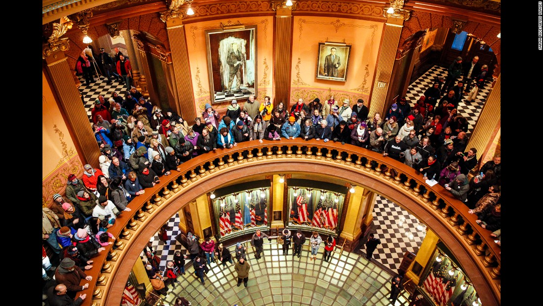 Protesters fill the rotunda of the Michigan State Capitol before electoral votes were cast in Lansing, Michigan, on Monday, December 19.
