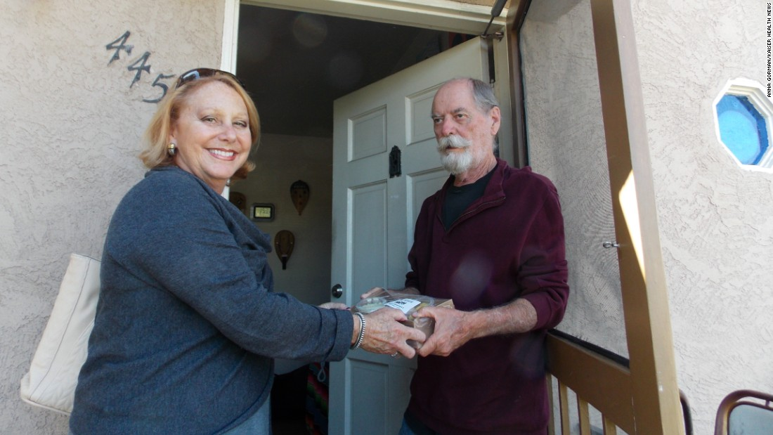 Debbie Case, CEO of the Meals on Wheels San Diego County, delivers lunch and dinner to 75-year-old David Kelly. Kelly lost his sight about two years ago and reluctantly gave up cooking.