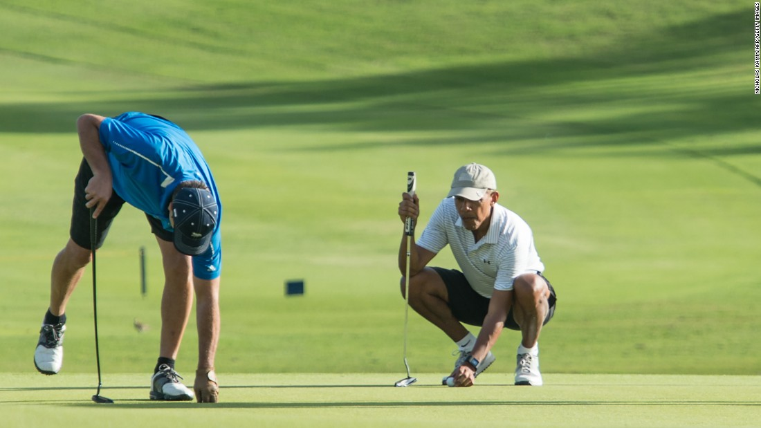 President Barack Obama lines up a putt during his annual Christmas vacation in Hawaii on Wednesday, December 21.