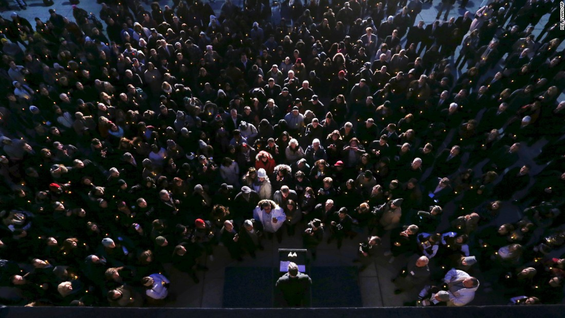"A large crowd fills the plaza outside the New Jersey Statehouse as Gov. Chris Christie talks <a href=""http://www.nj.com/politics/index.ssf/2016/12/christie_gets_a_heros_welcome_at_candlelight_vigil_for_drug_addiction.html"" target=""_blank"">during a candlelight vigil</a> on Wednesday, December 21. Christie called for an end to the ""shame"" associated with drug addiction. ""Everyone has the ability to fight back from this disease, but we have to give them the tools to do it,"" he said."