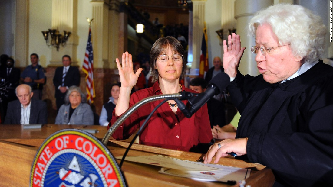 Colorado Supreme Court Chief Justice Nancy Rice swears in alternate elector Celeste Landry at the Capitol building in Denver on Monday, December 19. Rice swore in Landry after Michael Baca refused to cast his Electoral College vote for Hillary Clinton, the winner of the state's nine electoral votes.