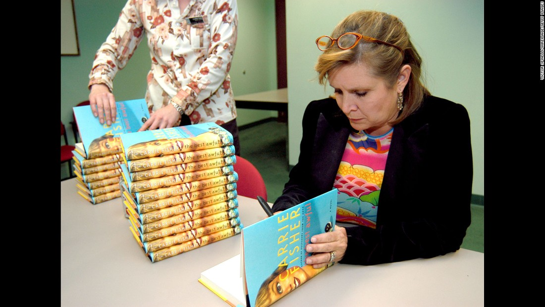 "Fisher attends a book signing for her novel, ""The Best Awful,"" in Beverly Hills, California, in 2004. The semi-autobiographical novel fictionalized events from Fisher's life."