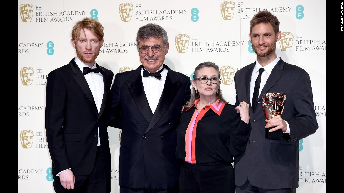 "Domhnall Gleeson, left, Hugo Sigman, Fisher, and Damian Szifron pose for a photo at the EE British Academy Film Awards in London on February 14, 2016. Their film, ""Wild Tales,"" won the BAFTA Award for best film not in the English language."