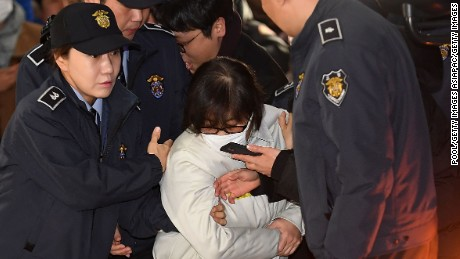 SEOUL, SOUTH KOREA - DECEMBER 24:  Choi Soon-Sil (C), longtime confidante of the South Korean President Park Geun-hye, arrives for questioning into her suspected role in political scandal at the office of the independent counsel on December 24, 2016 in Seoul, South Korea. A South Korean Independent Counsel Team summoned Choi who allegedly exploited her connections with Park to extort money and favors from the country's largest companies and manipulate government affairs from the shadows.  (Photo by Kim Min-Hee-Pool/Getty Images)