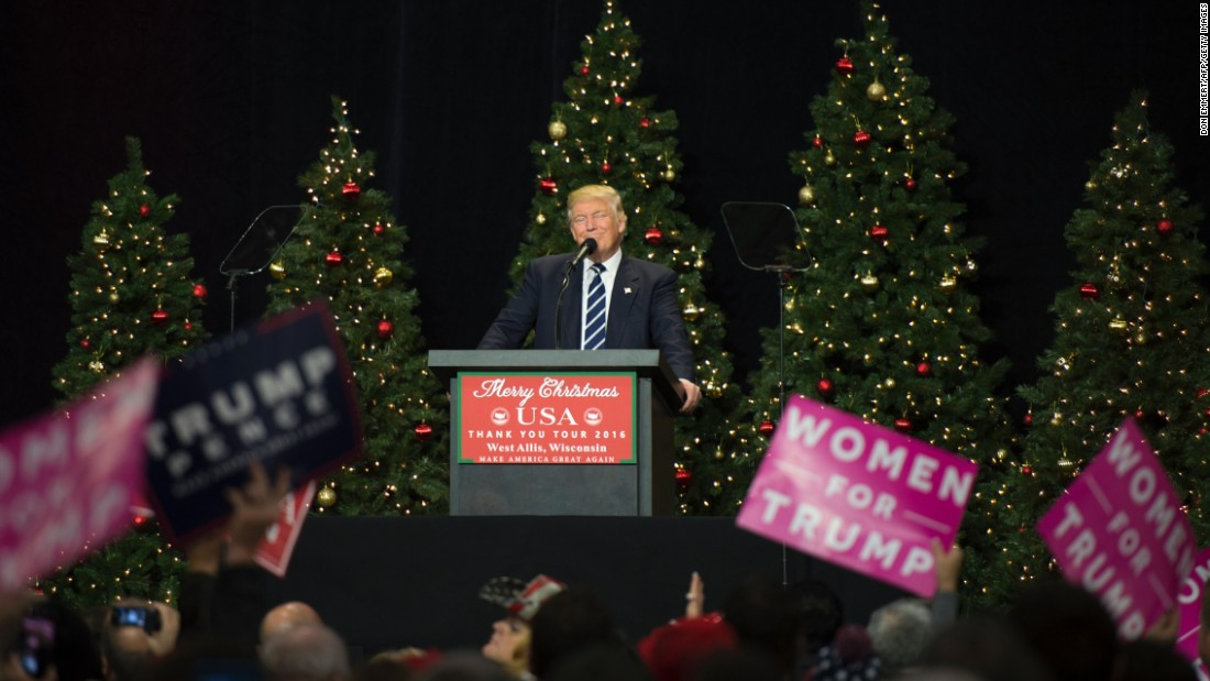 Trump, fist raised, wishes all a Merry Christmas