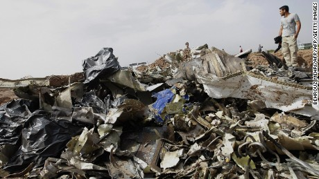 An Iranian man stands next to debris of the Caspian Airlines Tupolev-154 at its crash site near the city of Qazvin, northwest of Tehran, on July 16, 2009.