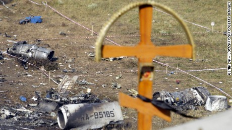 A cross is seen over the debris at the crash site the Russian Tupolev Tu-154 plane in Sukha Balka, 40kms from Ukrainian city of Donetsk/