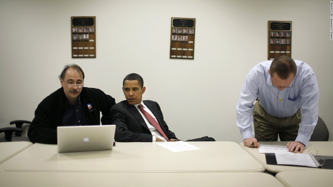 Obama huddles with his campaign staff, including Robert Gibbs, right, before a town-hall meeting in Erie, Pennsylvania, in April 2008. Gibbs would later be Obama's press secretary.