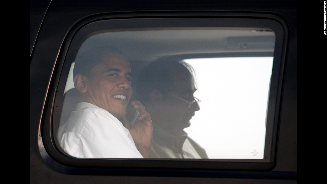 Obama and Axelrod sit on an airport tarmac in Washington in June 2008.