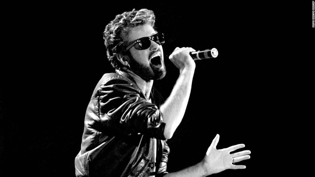 George Michael of Wham! performs at the Live Aid concert in London in 1985.