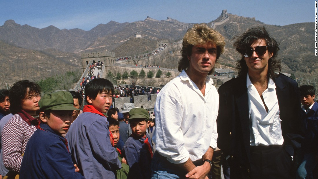 Michael and Ridgeley pose for a photo at the Great Wall of China in 1985, during Wham!'s historic visit as the first-ever Western pop band to perform in the communist country.