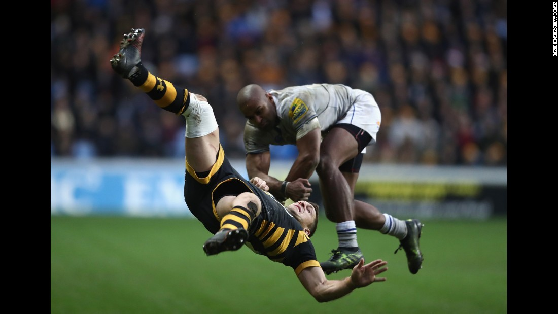 Jimmy Gopperth of the Wasps falls as he is challenged by Bath Rugby's Aled Brew during an Aviva Premiership match in Coventry, England, on Saturday. The Wasps won 40-26.