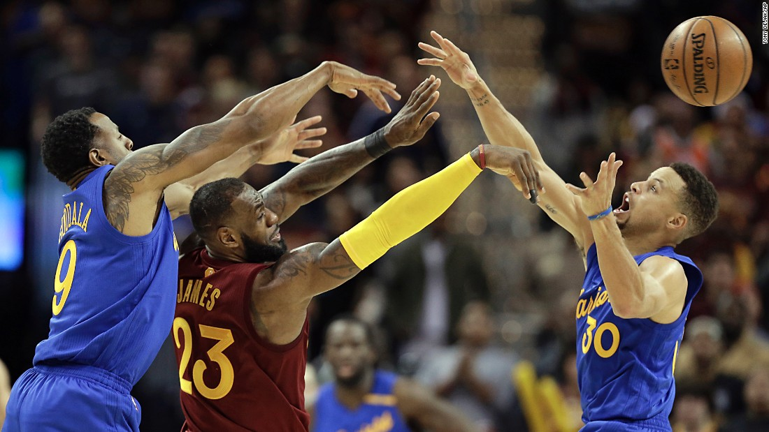 Cleveland's LeBron James makes a pass over Golden State's Stephen Curry during an NBA game in Cleveland on Christmas day. Golden State suffered a Christmas Day disappointment, losing 108-109 to Cleveland.