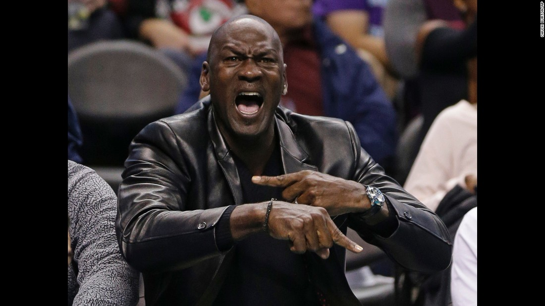 Charlotte Hornets owner Michael Jordan yells at an official during an NBA game against Chicago in Charlotte, North Carolina, on Friday. Jordan's team defeated Chicago 103-91.