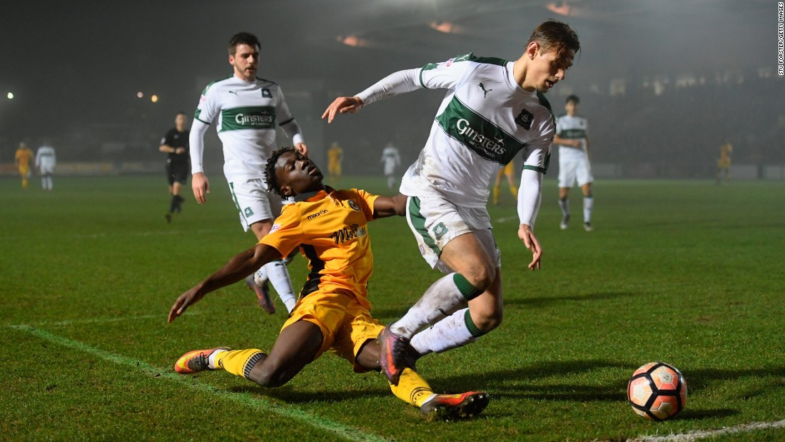 Newport's Jordan Green loses the ball to Plymouth's Oscar Threlkeld during an FA Cup second round replay match in Newport, Wales, on Wednesday. Plymouth won 1-0.