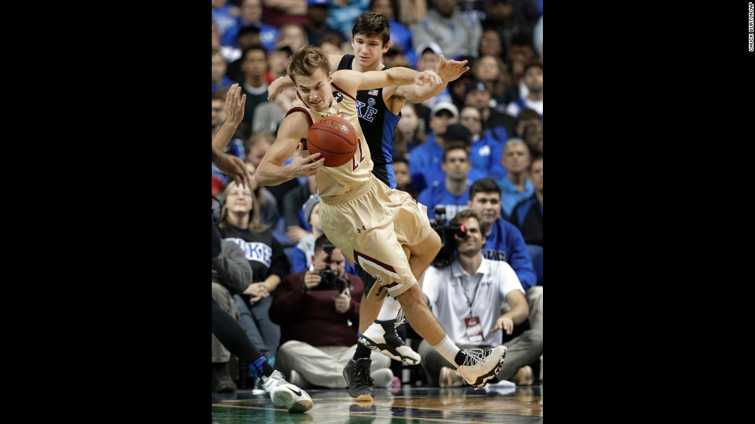 Duke's Grayson Allen trips Elon's Steven Santa Ana during an NCAA basketball game in Greensboro, North Carolina on Wednesday. Allen was called for a technical foul and sent to the bench after the play. This game marked the third time Allen has tripped an opponent since last February, and Duke has suspended him indefinitely.