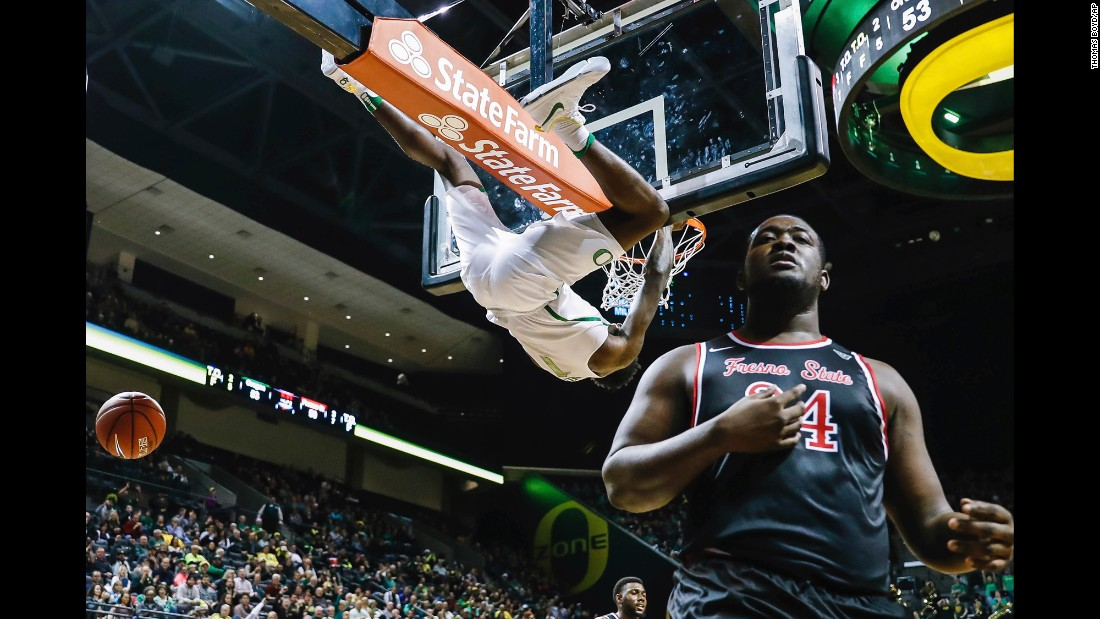 Oregon forward Jordan Bell hangs from the rim after a dunk against Fresno State center Terrell Carter II during an NCAA basketball game in Eugene, Oregon, last Tuesday.