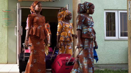 Girls leaving there accommodation, to head to Abuja airport.