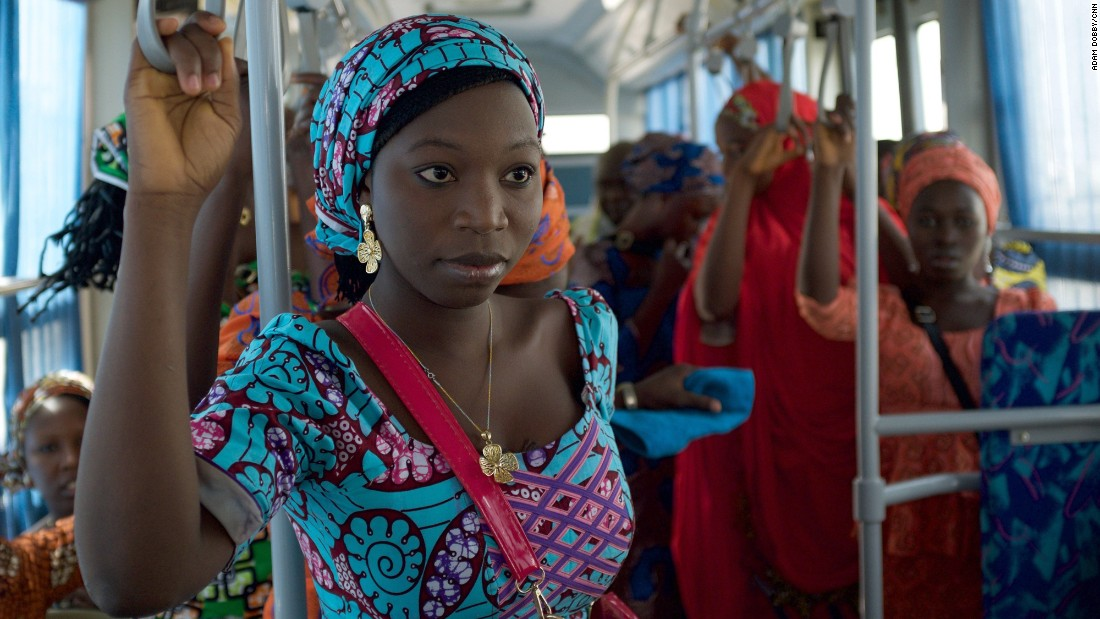 The girls ride on a bus in Abuja on their way to the airport in the first leg of their journey home.
