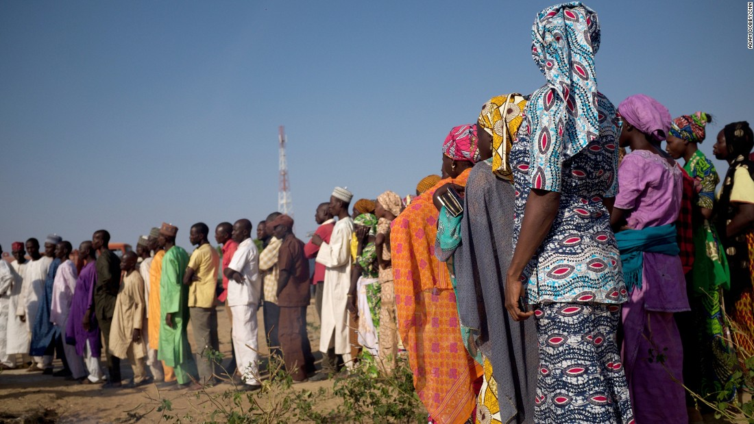 Family members line up on Friday to await the arrival of the girls, who were teenagers when they were taken but are now young women.