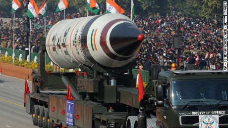 Missile Agni V is displayed during the Republic Day parade in New Delhi on January 26, 2013.  India marked its Republic Day with celebrations held under heavy security, especially in New Delhi where large areas were sealed off for an annual parade of military hardware at which Bhutan's king Jigme Khesar Namgyel Wangchuck was chief guest. AFP PHOTO/RAVEENDRAN        (Photo credit should read RAVEENDRAN/AFP/Getty Images)
