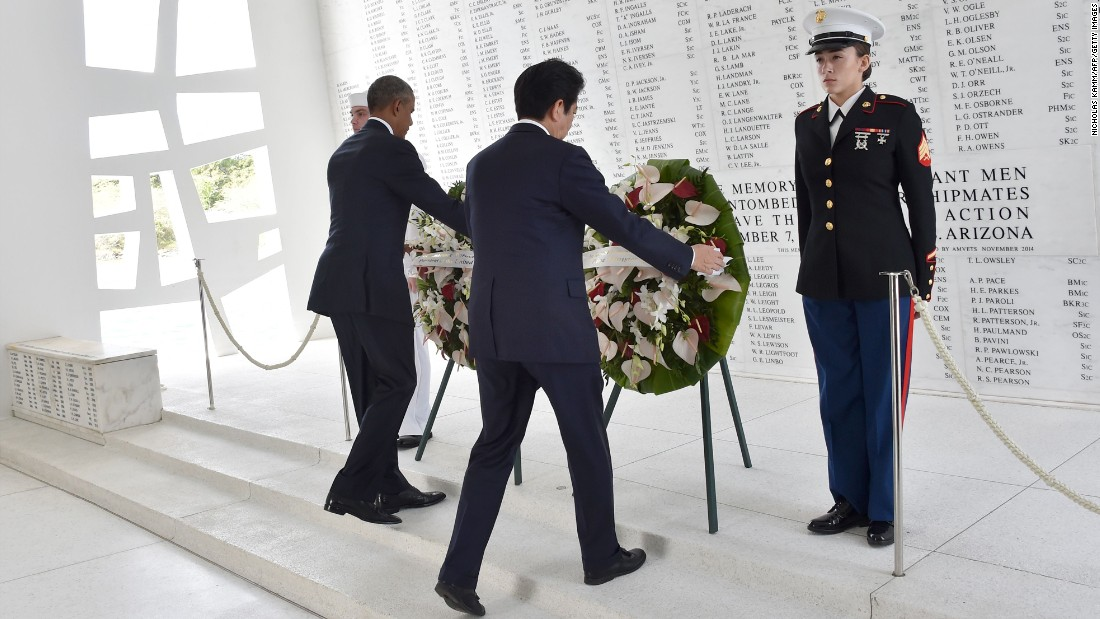 Obama and Abe place wreaths at the USS Arizona Memorial.