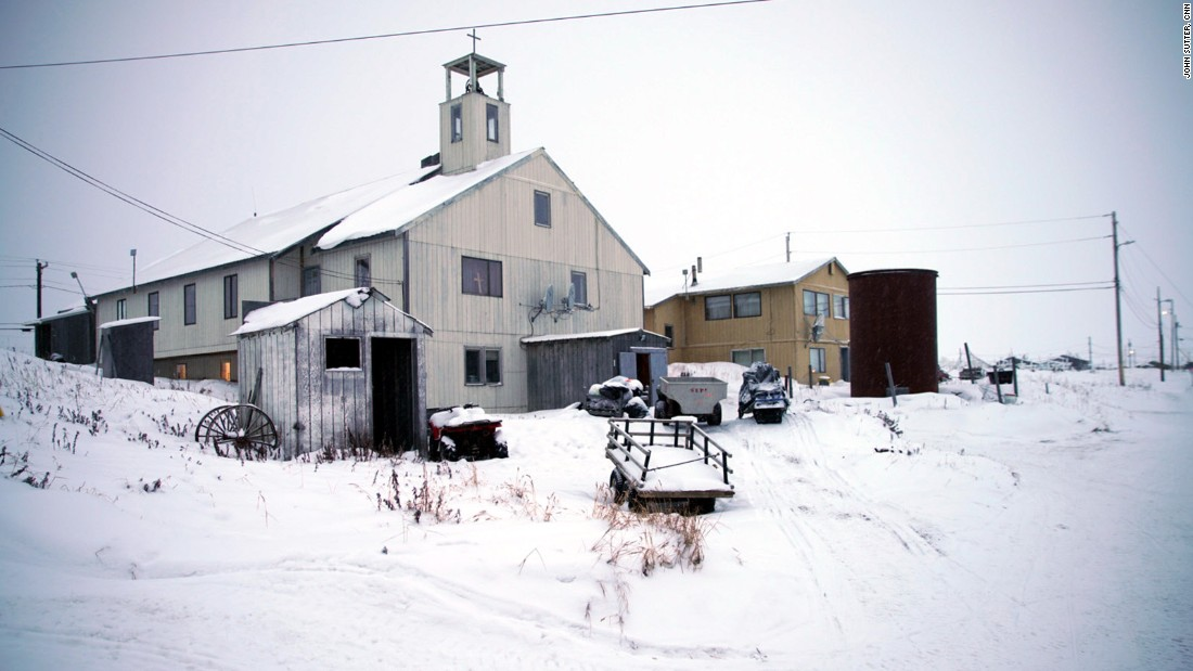 The local church is one of the main landmarks in town. There are only a couple of trucks on the island. Most people travel on foot or snowmobile.