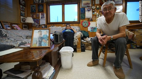 Shelton and Clara Kokeok, with a photo of their deceased son, Norman, who fell through the ice in 2007.