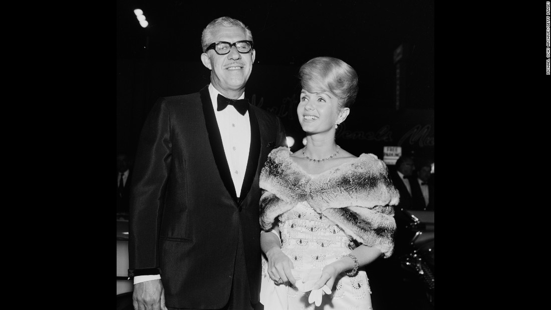 Reynolds and Harry Karl attend an event in Los Angeles in 1962.